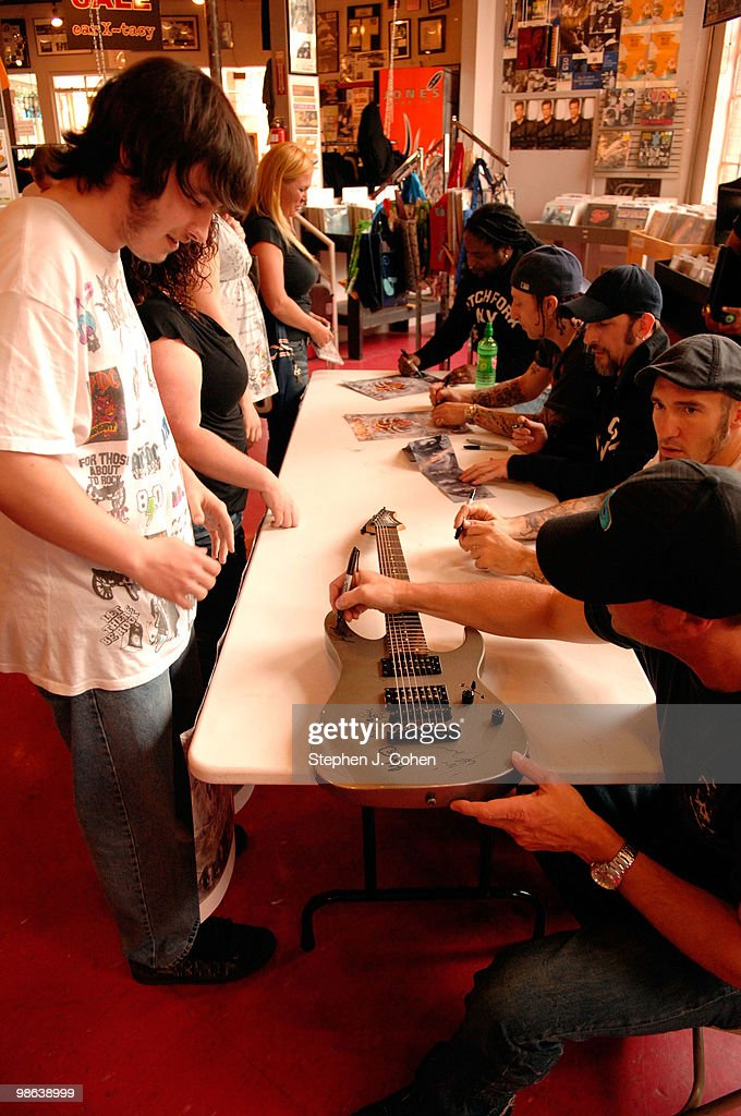 Vincent Hornsby, Clint Lowery, John Connolly, Morgan Rose, and Lajon Witherspoon attends the Sevendust signing in-store at Ear-X-Tacy on April 22, 2010 in Louisville, Kentucky.