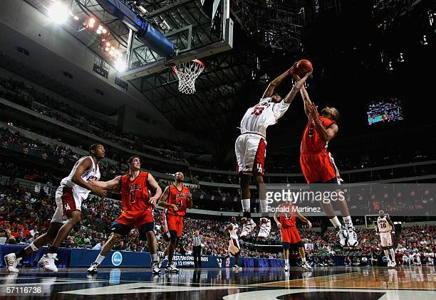 Vincent Hunter of the Arkansas Razorbacks is blocked by Charles Lee of the Bucknell Bison during the First Round of the 2006 NCAA Division 1 Men's...