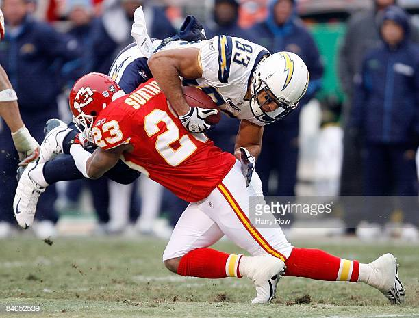 Vincent Jackson of the San Diego Chargers is hit by Patrick Surtain of the Kansas City Chiefs during the game on December 14 2008 at Arrowhead...