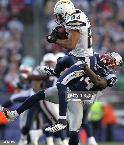 Vincent Jackson of the San Diego Chargers is stopped by Kyle Arrington of the New England Patriots in the first half at Gillette Stadium on September...