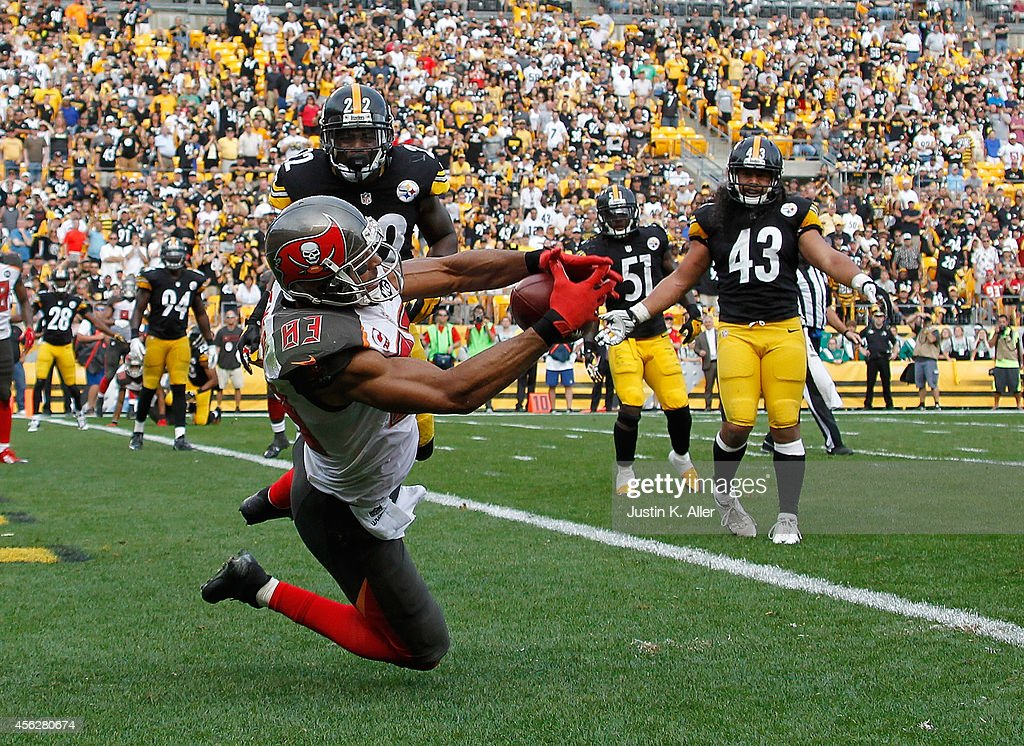 Vincent Jackson #83 of the Tampa Bay Buccaneers catches a game winning touchdown in the fourth quarter in front of William Gay #22 of the Pittsburgh Steelers at Heinz Field on September 28, 2014 in Pittsburgh, Pennsylvania. Tampa Bay won the game 27-24
