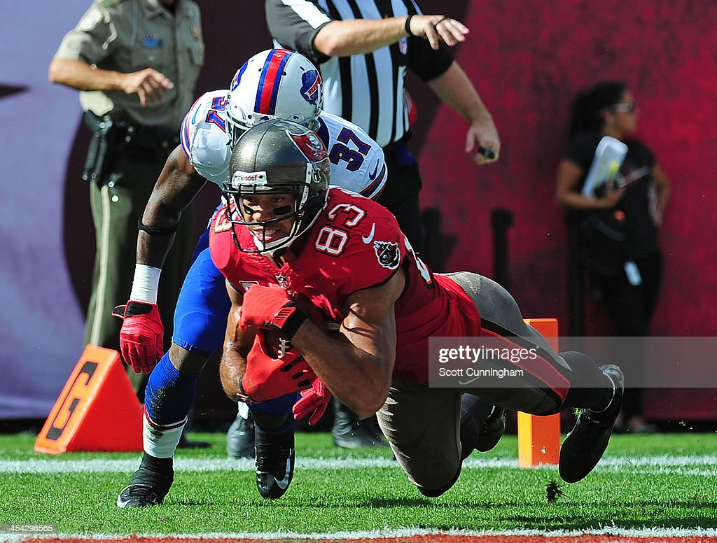Vincent Jackson #83 of the Tampa Bay Buccaneers makes a catch for a touchdown against Nickell Robey #37 of the Buffalo Bills at Raymond James Stadium on December 8 2013 in Tampa, Florida.