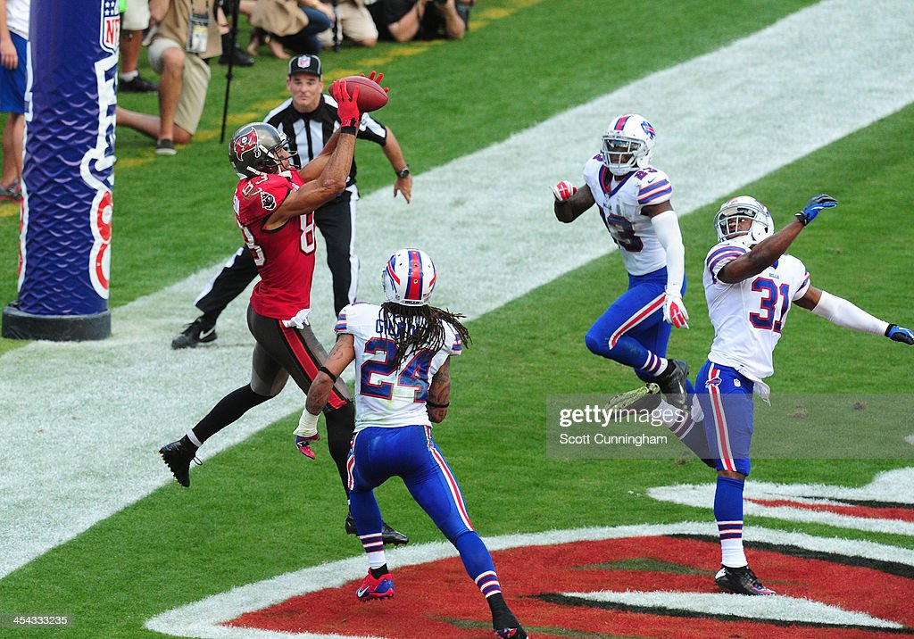 Vincent Jackson #83 of the Tampa Bay Buccaneers makes a catch that was initially ruled a touchdown but was overturned by replay against the Buffalo Bills at Raymond James Stadium on December 8 2013 in Tampa, Florida.