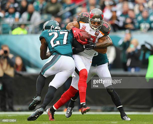 Vincent Jackson of the Tampa Bay Buccaneers scores a touchdown in the second quarter against the Malcolm Jenkins and Nolan Carroll of the...