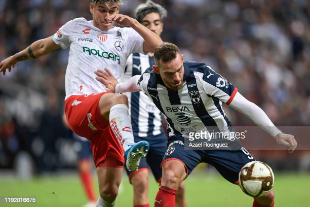 Vincent Janssen #9 of Monterrey fights for the ball with Alexis Peña #4 of Necaxa during the Semifinals first leg match between Monterrey and Necaxa...