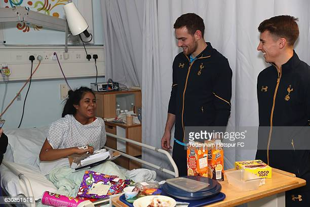 Vincent Janssen and Tom Carroll of Tottenham Hotspur deliver and help a young patient at Whittington Hospital with her present as Tottenham Hotspur...