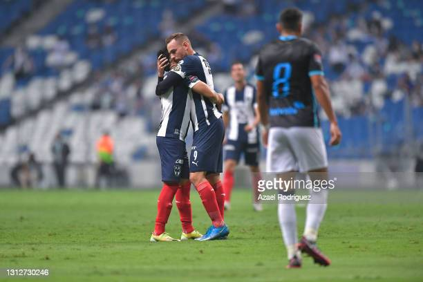 Vincent Janssen of Monterrey celebrates with teammate after scoring his team's second goal during a second leg match between Monterrey and Atletico...
