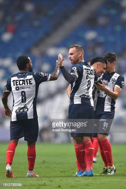 Vincent Janssen of Monterrey celebrates with teammates after scoring his team's second goal during a second leg match between Monterrey and Atletico...