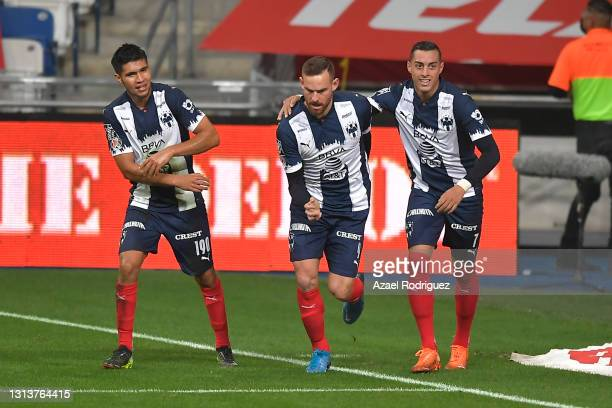 Vincent Janssen of Monterrey celebrates with teammates Rogelio Funes Mori and Luis Sánchez after scoring his team's first goal during the 12th round...