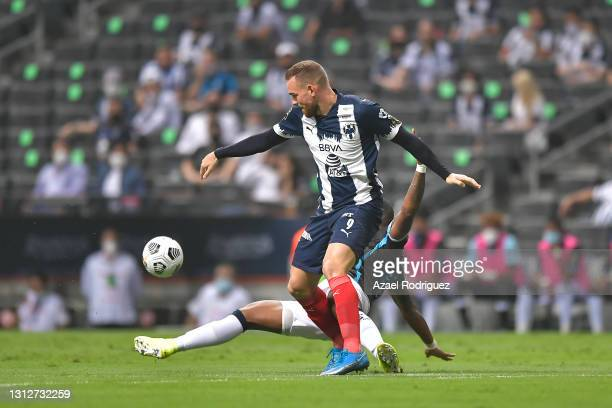 Vincent Janssen of Monterrey fights for the ball with Carlitos Ferreras of Atlético Pantoja during a second leg match between Monterrey and Atletico...