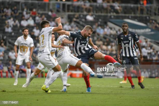 Vincent Janssen of Monterrey fights for the ball with Gerardo Moreno and Leonel López of Pumas during the 2nd round match between Monterrey and Pumas...