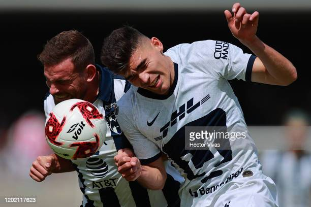 Vincent Janssen of Monterrey struggles for the ball against Johan Vasquez of Pumas UNAM during the 3rd round match between Pumas UNAM and Monterrey...