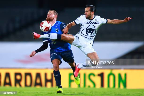 Vincent Janssen of Monterrey struggles for the ball against Luis Quintana of Pumas UNAM during the 4th round match between Pumas UNAM and Monterrey...