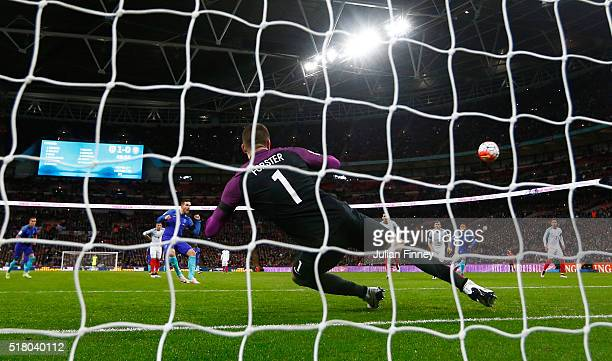 Vincent Janssen of the Netherlands scores the equalising goal from a penalty past Fraser Forster goalkeeper of England during the International...