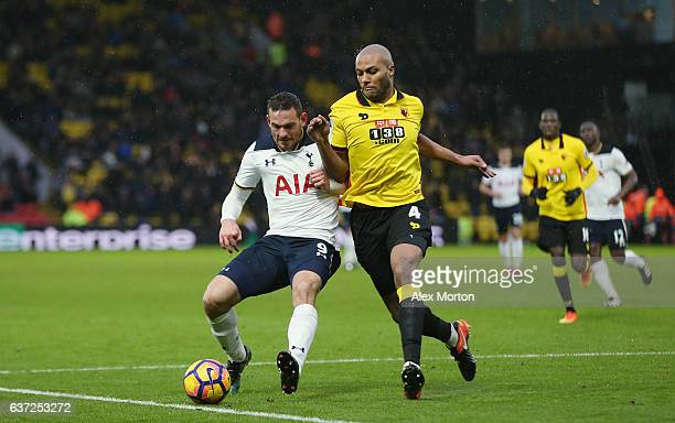 Vincent Janssen of Tottenham and Younnes Kaboul of Watford during the Premier League match between Watford and Tottenham Hotspur at Vicarage Road on...