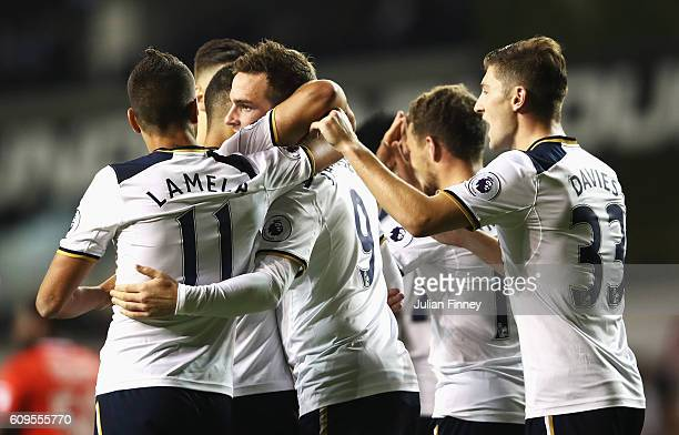 Vincent Janssen of Tottenham Hotspur celebrates scoring his sides third goal with team mates during the EFL Cup Third Round match between Tottenham...