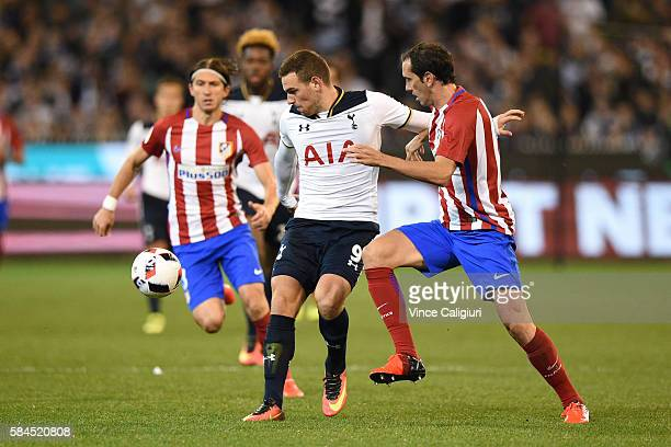 Vincent Janssen of Tottenham Hotspur competes for the ball against Diego Godin of Atletico de Madrid during 2016 International Champions Cup...