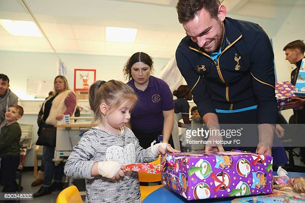 Vincent Janssen of Tottenham Hotspur delivers and helps a young patient at Whittington Hospital with her present as Tottenham Hotspur Players Deliver...