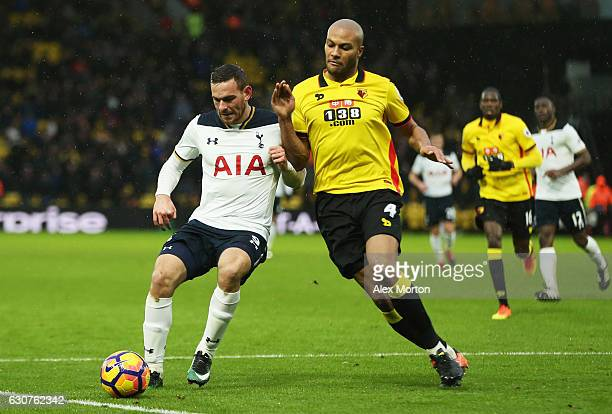 Vincent Janssen of Tottenham Hotspur holds off Younes Kaboul of Watford during the Premier League match between Watford and Tottenham Hotspur at...