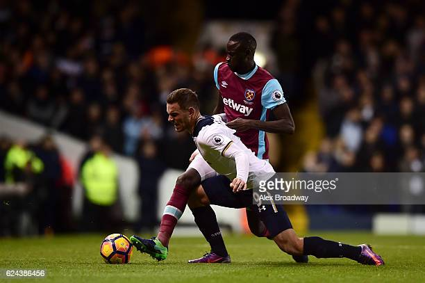 Vincent Janssen of Tottenham Hotspur is fouled by Cheikhou Kouyate of West Ham United during the Premier League match between Tottenham Hotspur and...