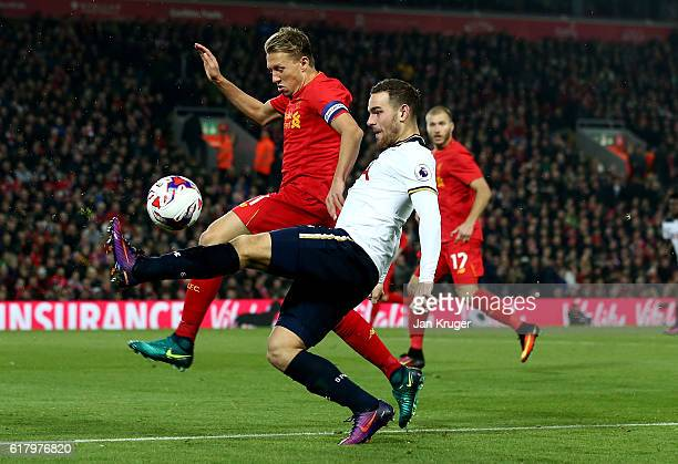 Vincent Janssen of Tottenham Hotspur tackles Lucas Leiva of Liverpool during the EFL Cup fourth round match between Liverpool and Tottenham Hotspur...