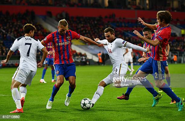 Vincent Janssen of Tottenham Hotspur takes on Aleksey Berezutskiy and Mario Fernandes of CSKA Moscow during the UEFA Champions League Group E match...
