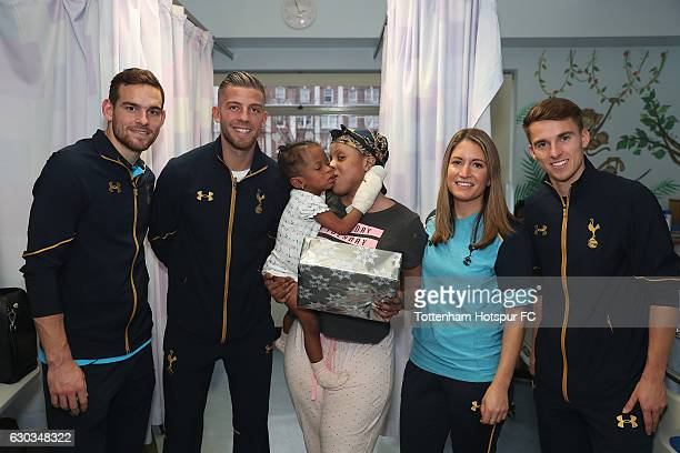 Vincent Janssen Toby Alderweireld Jenna Schillaci and Tom Carroll of Tottenham Hotspur pose for the camera with a young patient as they visit...