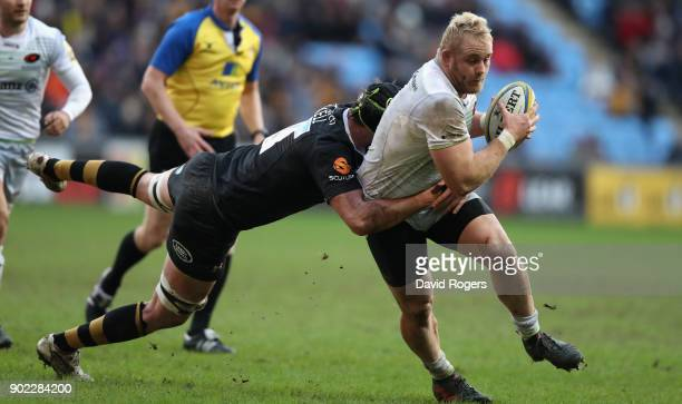 Vincent Koch of Saracens is tackled by James Gaskell during the Aviva Premiership match between Wasps and Saracens at The Ricoh Arena on January 7...