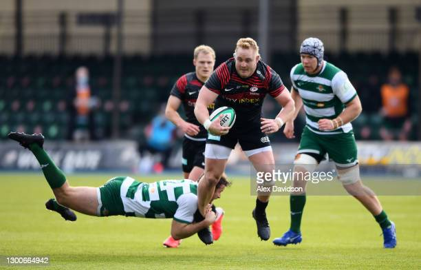 Vincent Koch of Saracens is tackled by Pat Howard of Ealing Trailfinders during the Trailfinders Challenge Cup match between Saracens and Ealing...