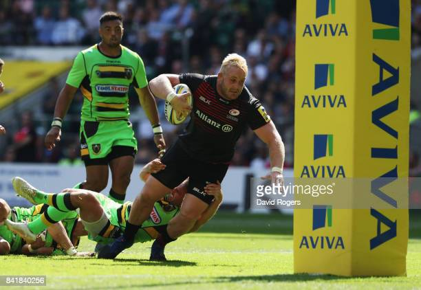 Vincent Koch of Saracens lunges to score their seventh try during the Aviva Premiership match between Saracens and Northampton Saints at Twickenham...