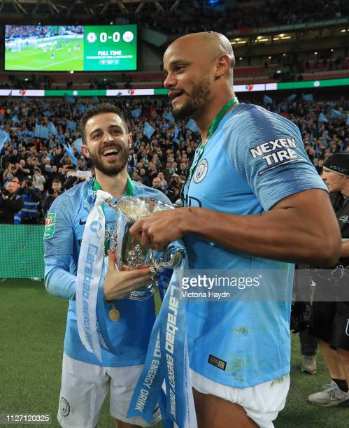 Vincent Kompany and Bernardo Silva of Manchester City celebrate with the trophy after winning the Carabao Cup Final between Chelsea and Manchester...