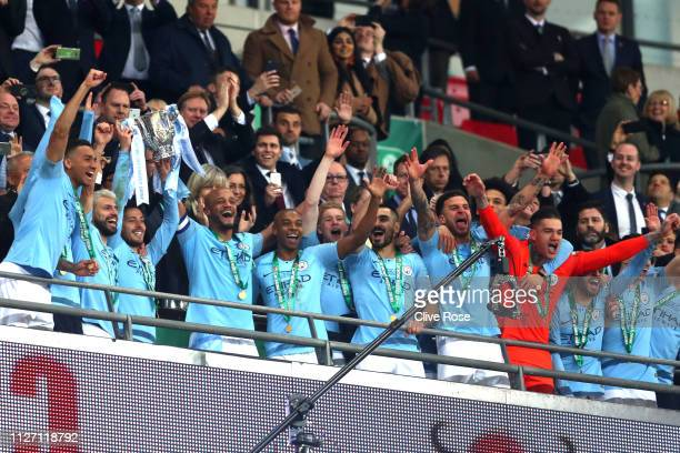 Vincent Kompany and David Silva of Manchester City lift the trophy following the Carabao Cup Final between Chelsea and Manchester City at Wembley...