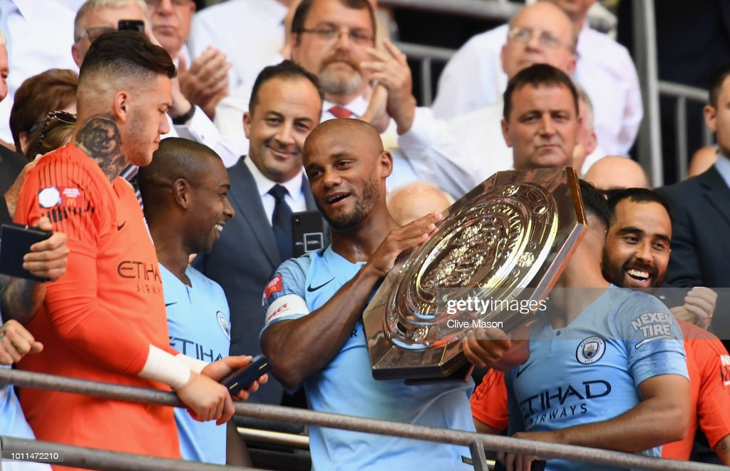 https://media.gettyimages.com/photos/vincent-kompany-and-fernandinho-prepare-to-lift-the-community-shield-picture-id1011472210