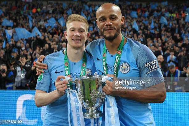 Vincent Kompany and Kevin De Bruyne of Manchester City celebrate victory with the trophy after the Carabao Cup Final between Chelsea and Manchester...