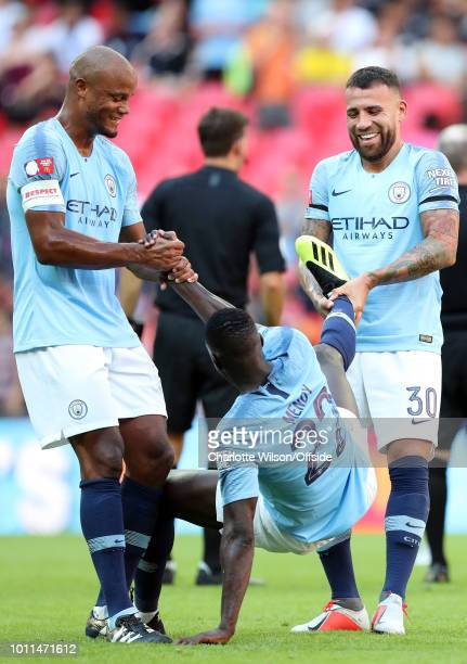 Vincent Kompany and Nicolas Otamendi laugh as they pull Benjamin Mendy of Man City up from the ground by his arm and leg during the FA Community...