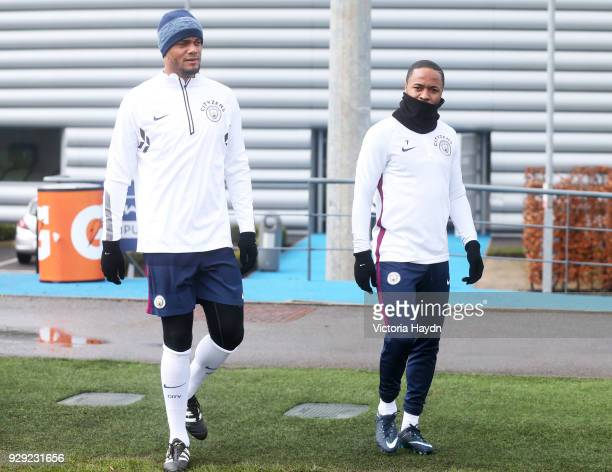Vincent Kompany and Raheem Sterling walk to training at Manchester City Football Academy on March 8 2018 in Manchester England