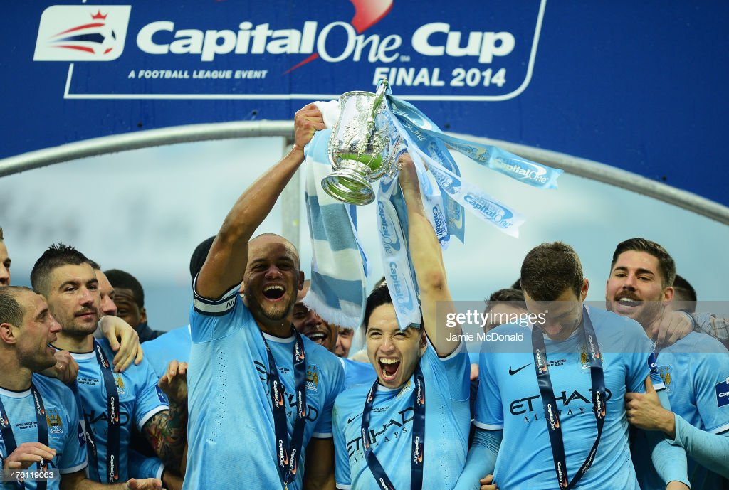 Vincent Kompany and Samir Nasri of Manchester City lift the trophy with team mates after the Capital One Cup Final between Manchester City and Sunderland at Wembley Stadium on March 2, 2014 in London, England.