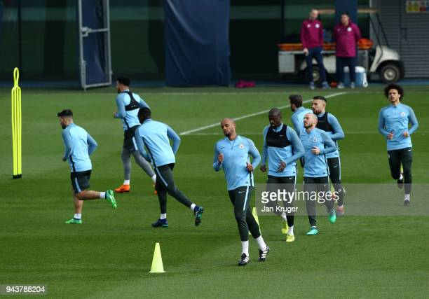 Vincent Kompany and team mates warm up during a training session at Manchester City Football Academy on April 9 2018 in Manchester England