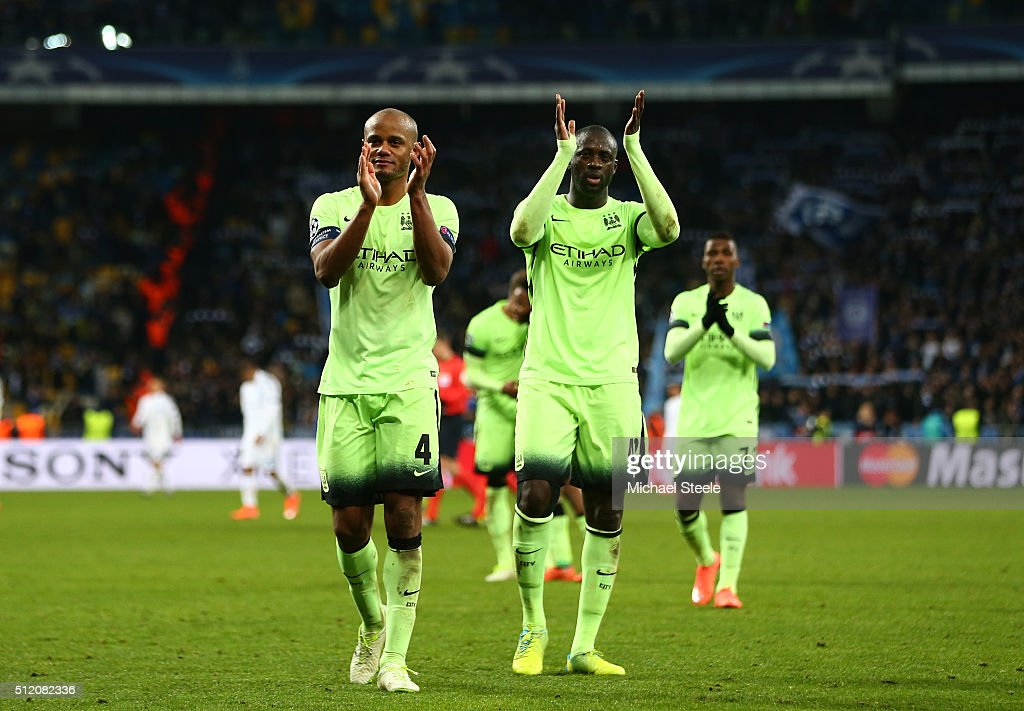 Vincent Kompany and Yaya Toure of Manchester City applaud the travelling fans following their team's 3-1 victory during the UEFA Champions League round of 16, first leg match between FC Dynamo Kyiv and Manchester City FC at the Olympic Stadium on February 24, 2016 in Kiev, Ukraine.