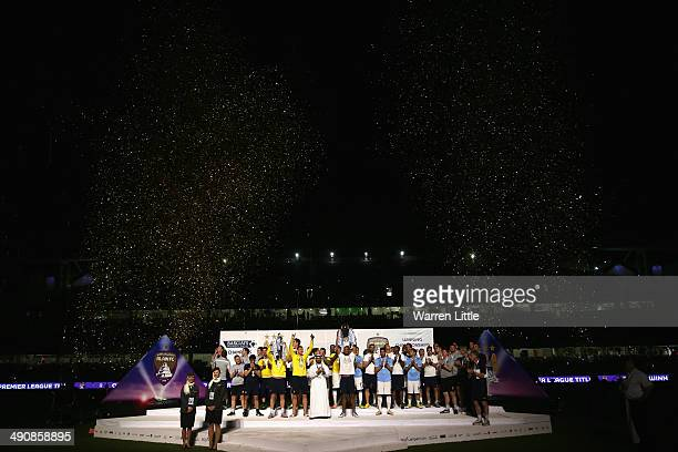 Vincent Kompany, Captain of Manchester City lifts the Premier League trophy after the friendly match between Al Ain and Manchester City at Hazza bin...