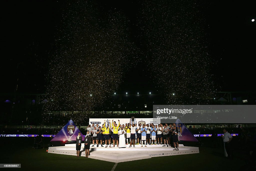 Vincent Kompany, Captain of Manchester City lifts the Premier League trophy after the friendly match between Al Ain and Manchester City at Hazza bin Zayed Stadium on May 15, 2014 in Al Ain, United Arab Emirates.