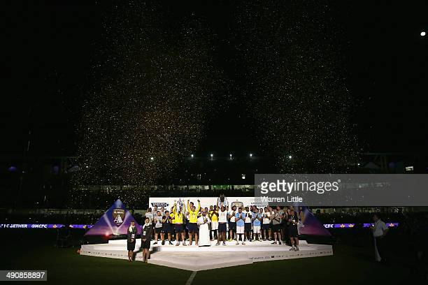 Vincent Kompany Captain of Manchester City lifts the Premier League trophy after the friendly match between Al Ain and Manchester City at Hazza bin...