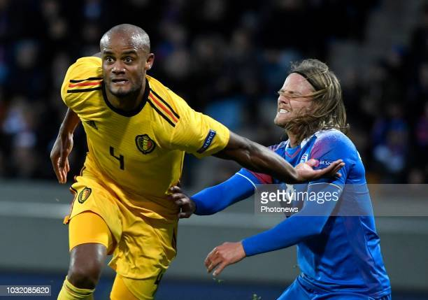 Vincent Kompany defender of Belgium and Birkir Bjarnason of Iceland pictured during the UEFA Nations League match between Iceland and Belgium on...