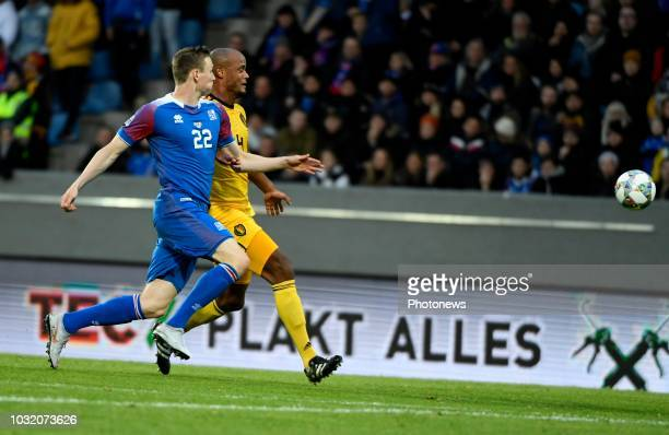 Vincent Kompany defender of Belgium and Jon Dadi Bodvarsson of Iceland pictured during the UEFA Nations League match between Iceland and Belgium on...