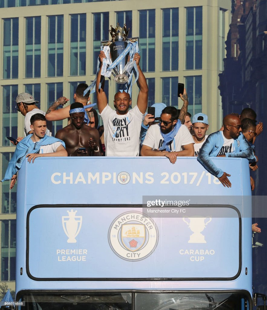 Vincent Kompany holds the Premier League trophy aloft during a victory Parade by Manchester City FC on May 14, 2018 in Manchester, England.