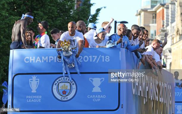 Vincent Kompany holds the Premier League Trophy during a victory Parade by Manchester City FC on May 14 2018 in Manchester England