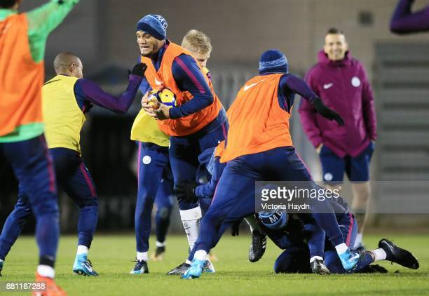 Vincent Kompany in action during training at Manchester City Football Academy on November 28 2017 in Manchester England