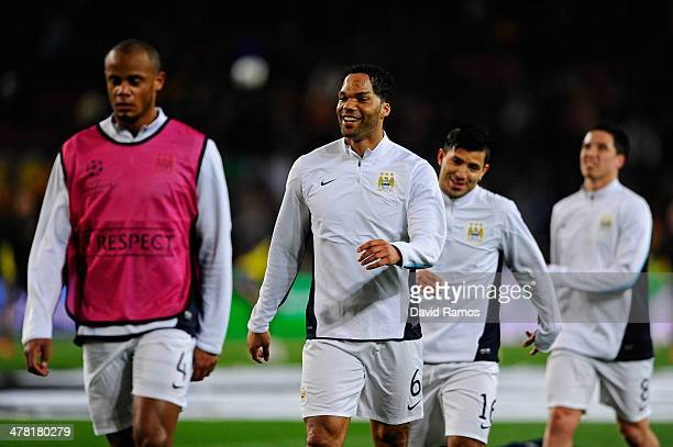 Vincent Kompany, Joleon Lescott, Sergio Aguero and Sami Nasri of Manchester City warm up prior to kickoff during the UEFA Champions League Round of...