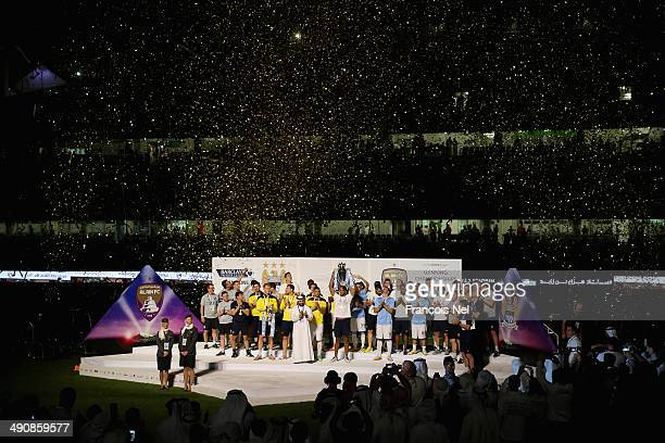 Vincent Kompany lifts the throphy after the friendly match between Al Ain and Manchester at Hazza bin Zayed Stadium on May 15, 2014 in Al Ain, United...