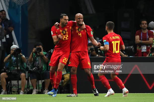 Vincent Kompany Nacer Chadli and Eden Hazard of Belgium celebrate after Fernandinho of Brazil scored an own goal to make it 01 during the 2018 FIFA...